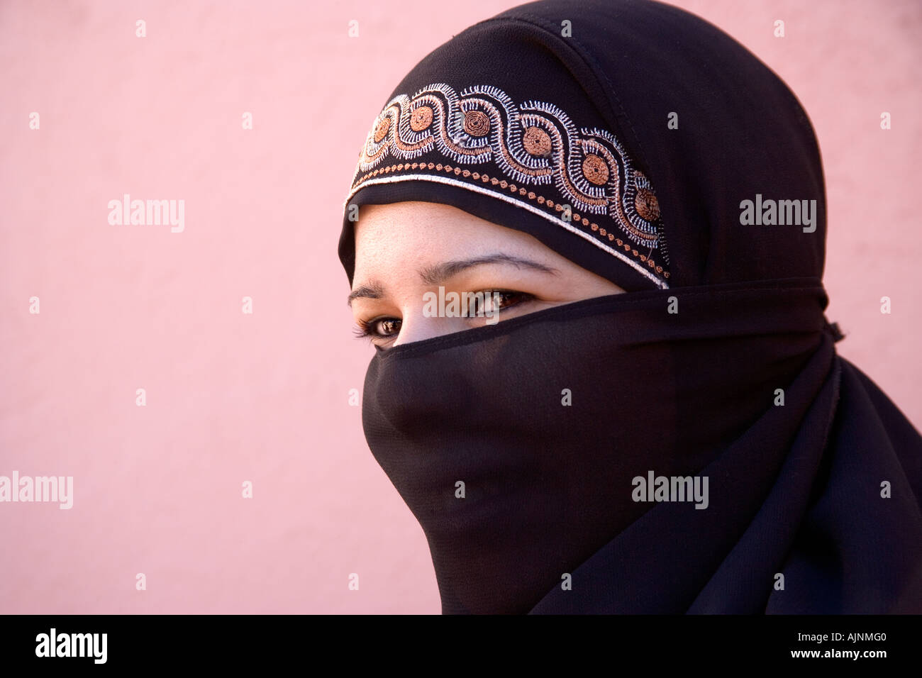Portrait of Young Veiled Moslem Woman in Marrakeesh, Morocco - Stock Image