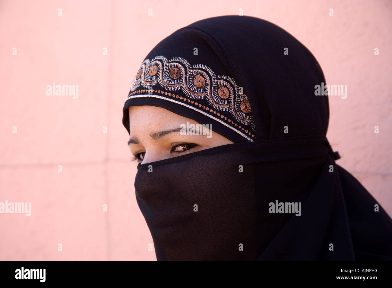 Portrait of a Young Veiled Moslem Woman of Marrakeesh, Morocco - Stock Image