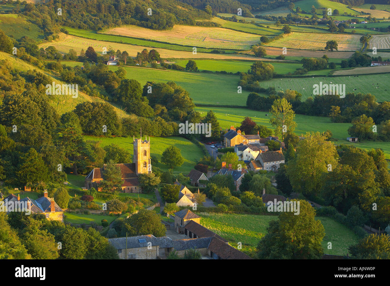 the rolling countryside of the Somerset/Dorset border with the village of Corton Denham, Somerset, England, UK. - Stock Image