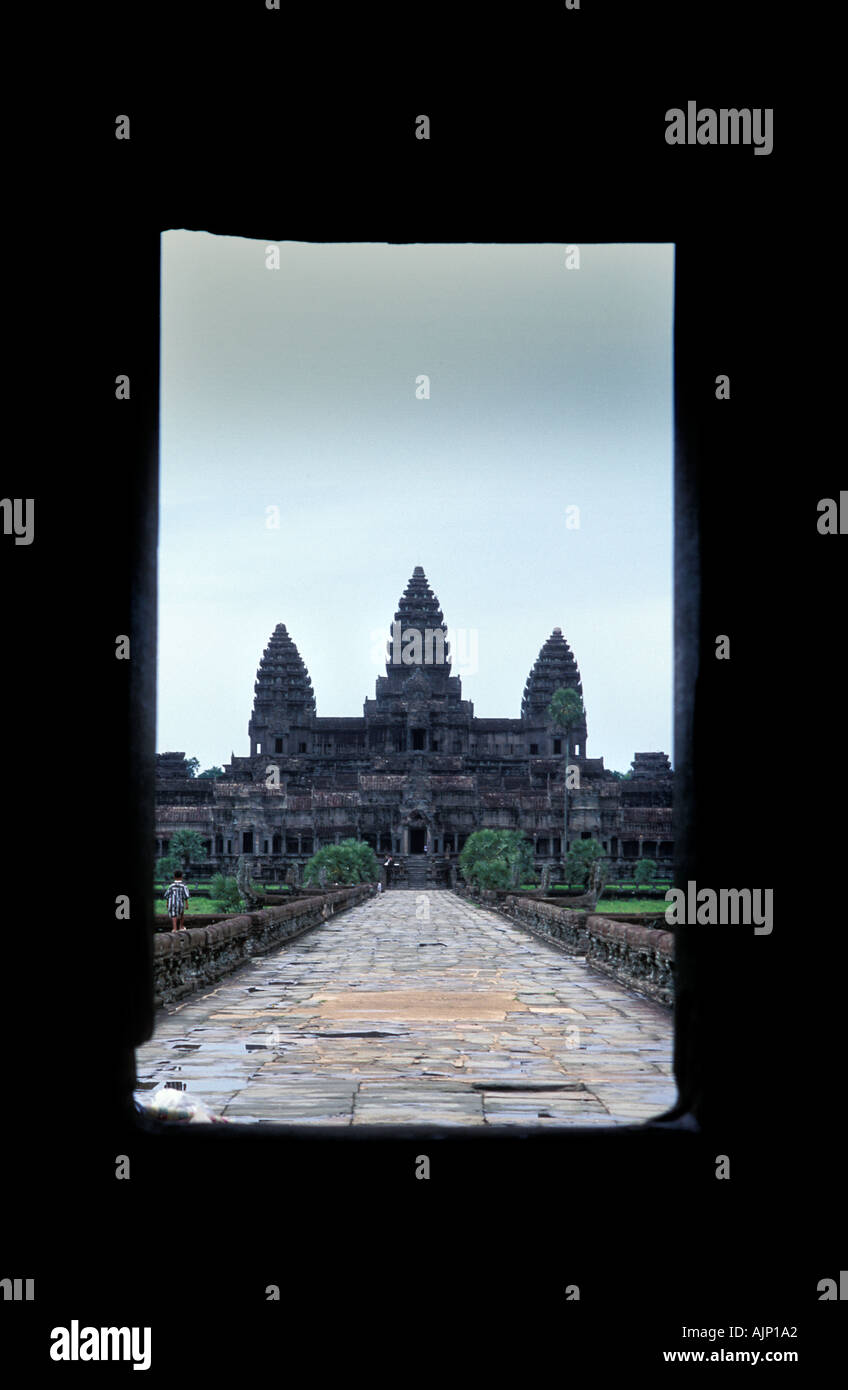 Classic view through an entrance portico of the Khmer site of Angkor Wat and the cruciform platform Cambodia - Stock Image