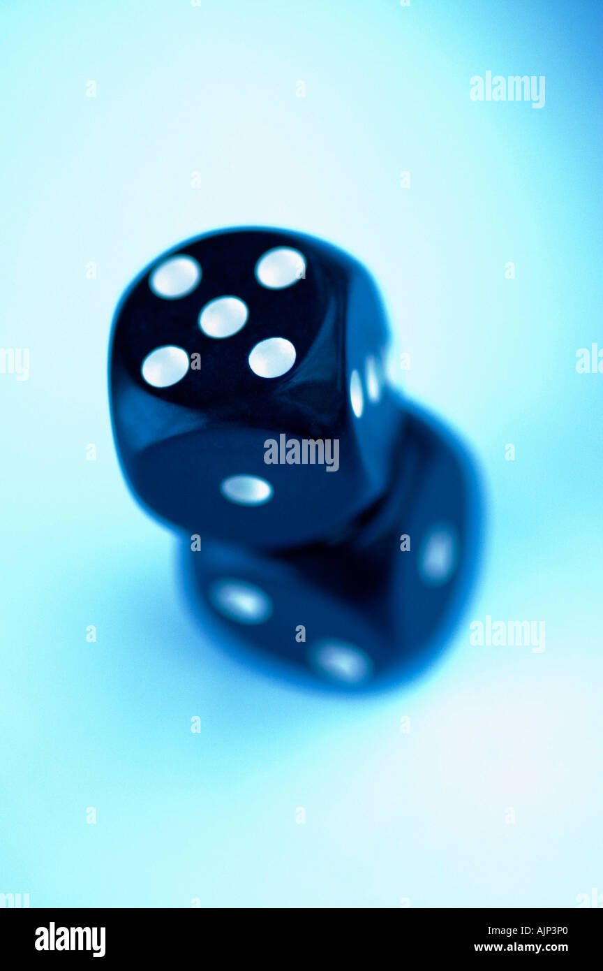 DICE WITH FIVE SHOWING ON BLUE BACKGROUND. GAMBLING. ODDS, LUCK, CONCEPT - Stock Image