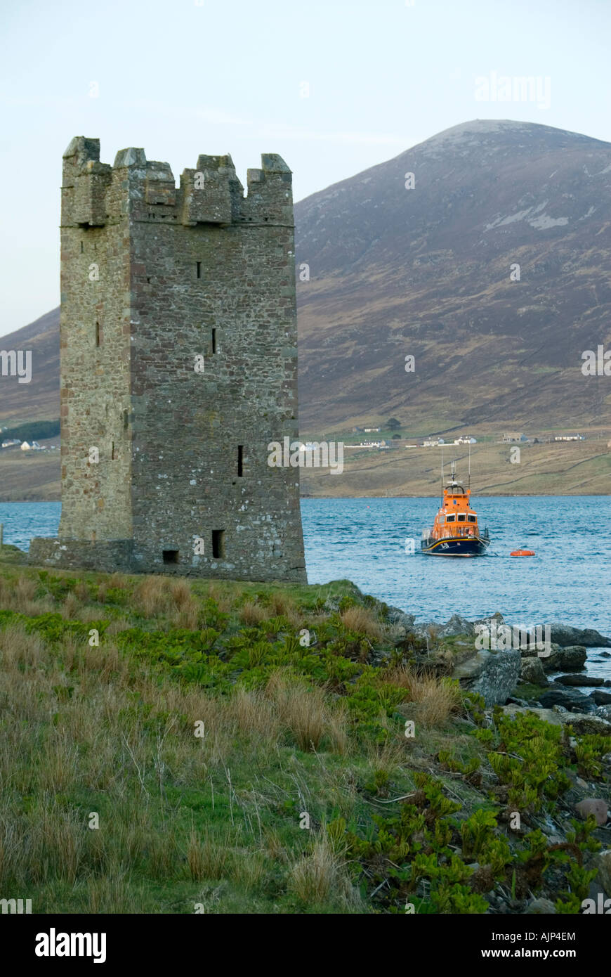 Carrick Kildavnet Castle and Corraun Hill, Achill Island, County Mayo, Ireland - Stock Image