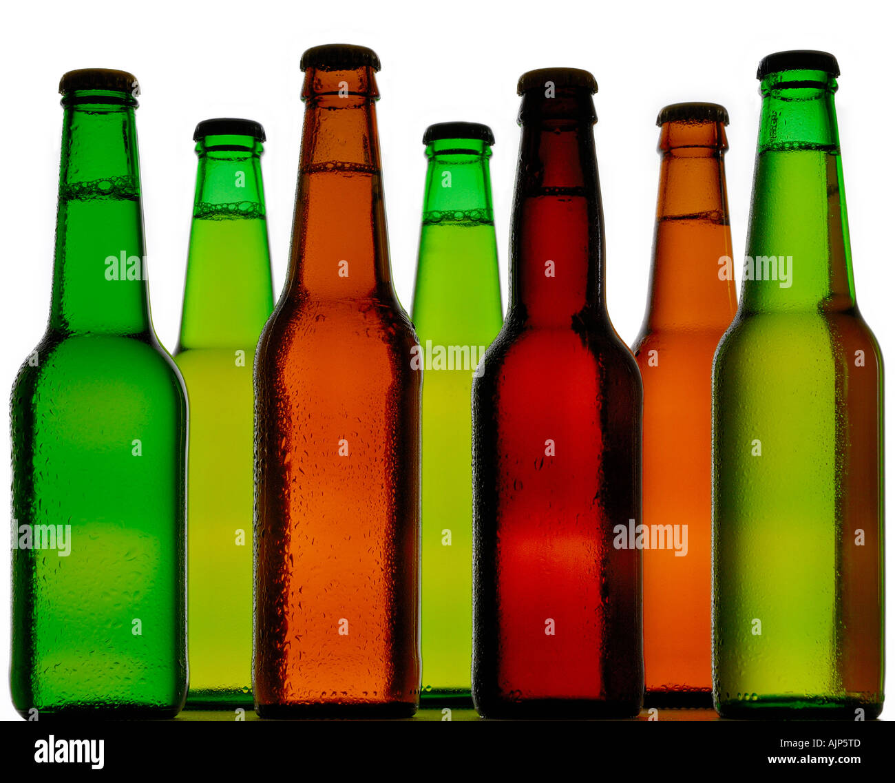 BEER COLORFUL BOTTLES OF COLD BEER SILHOUETTED ON WHITE BACKGROUND Stock Photo