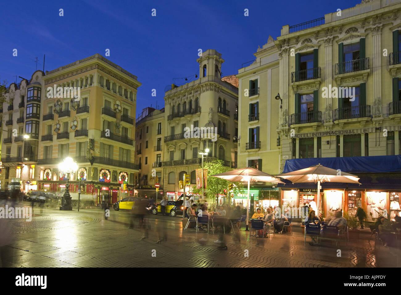 Spain Barcelona Las Ramblas dusk tourists street cafe at night Stock Photo