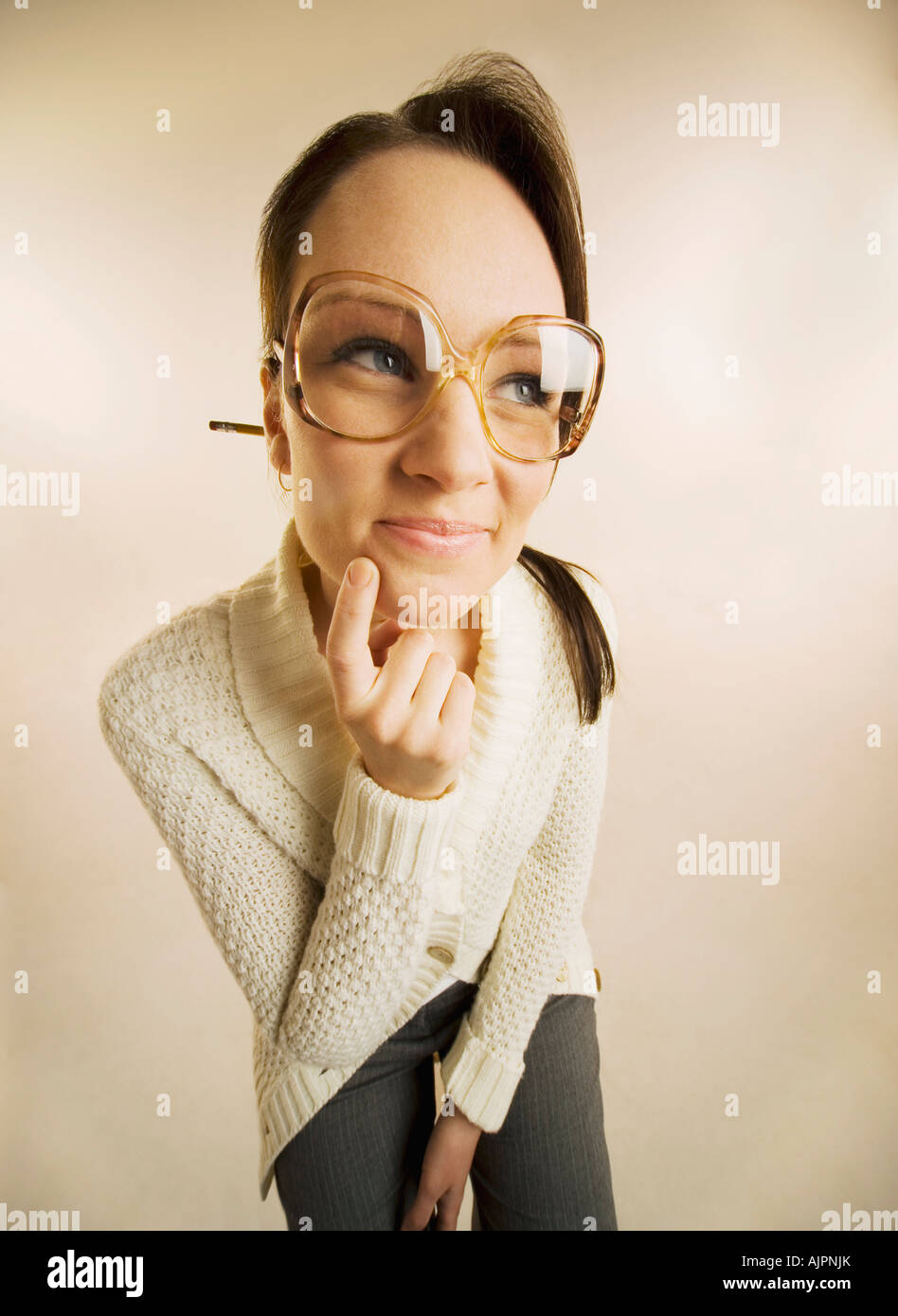 Wide-angle view of a woman wearing eyeglasses - Stock Image