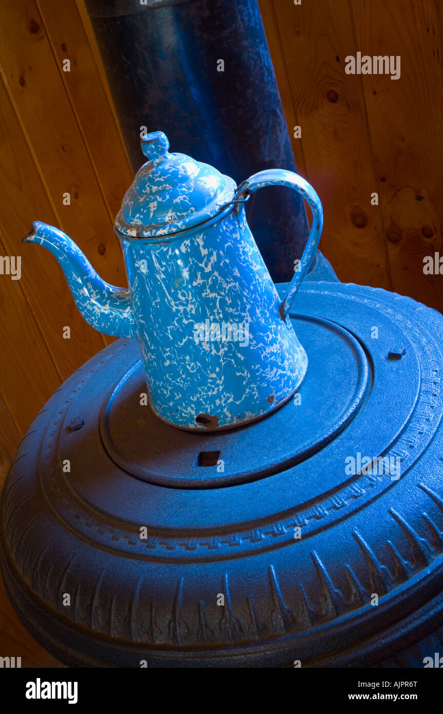 Antique coffee pot on pot belly wood stove - Stock Image