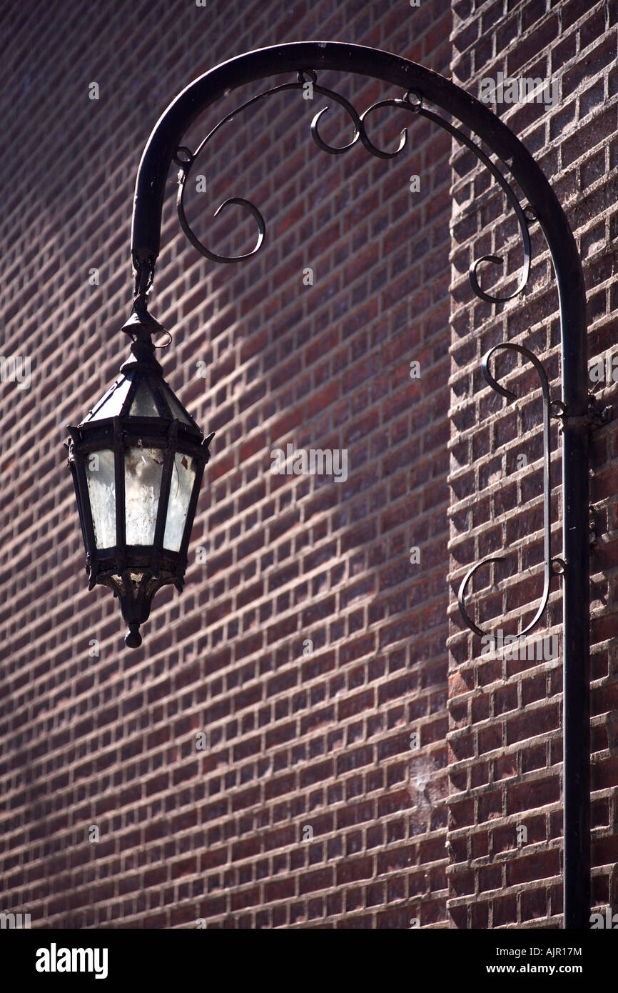 Old metallic lamp at the outside wall of Recoleta Cemetery. Buenos Aires, Argentina Stock Photo