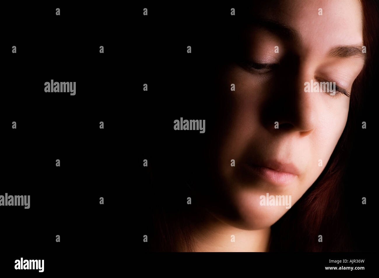 Face of young woman - Stock Image