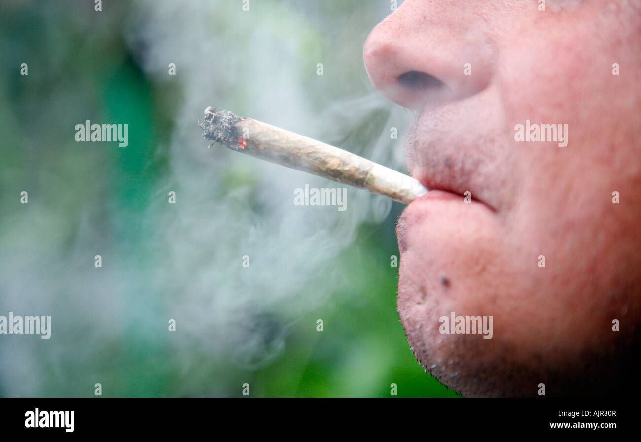 Close up of a man smoking a marijuana cigarette, Spain - Stock Image