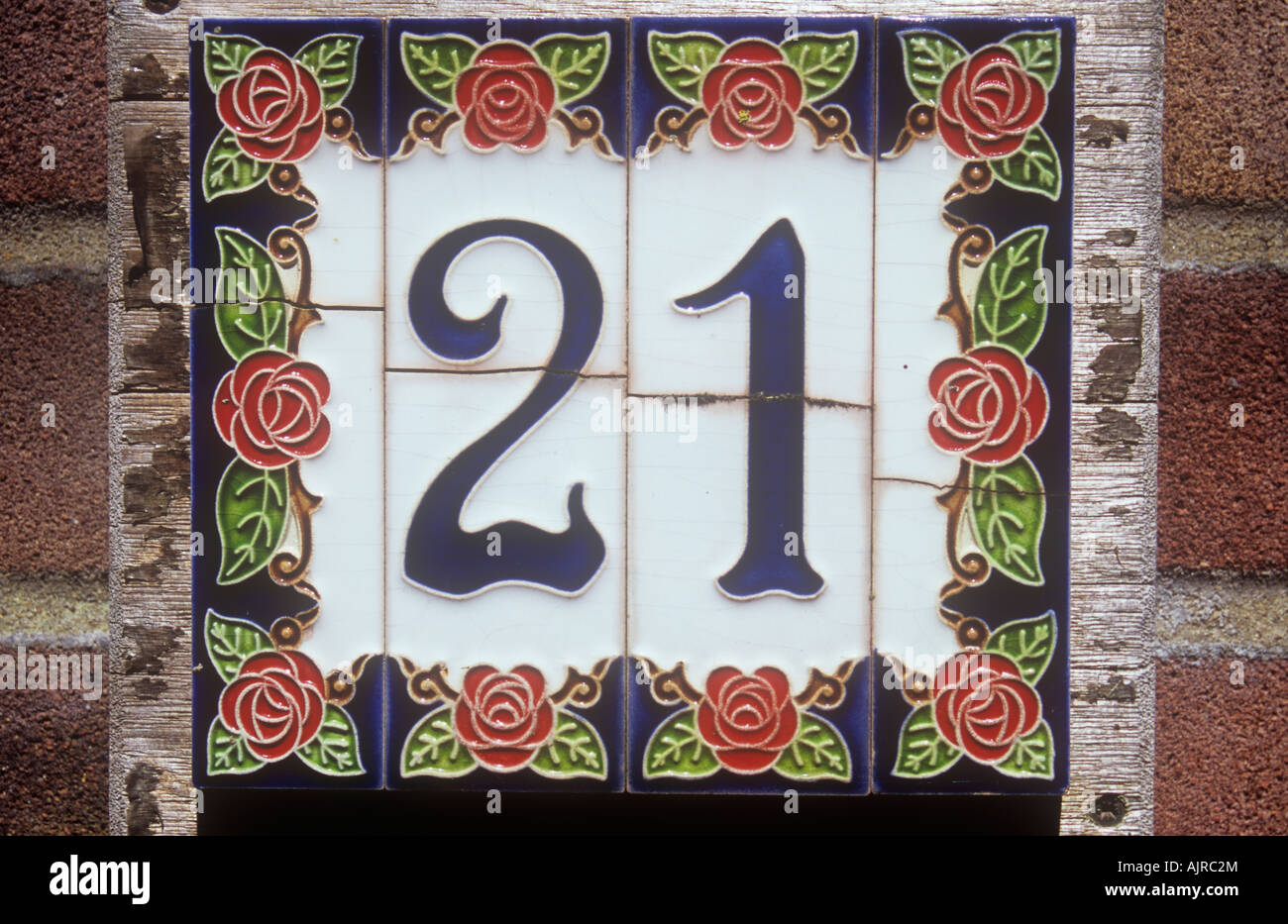 Ceramic tile house number stock photos ceramic tile house number close up of house number tiles stating 21 decorated in british arts and crafts movement style dailygadgetfo Images