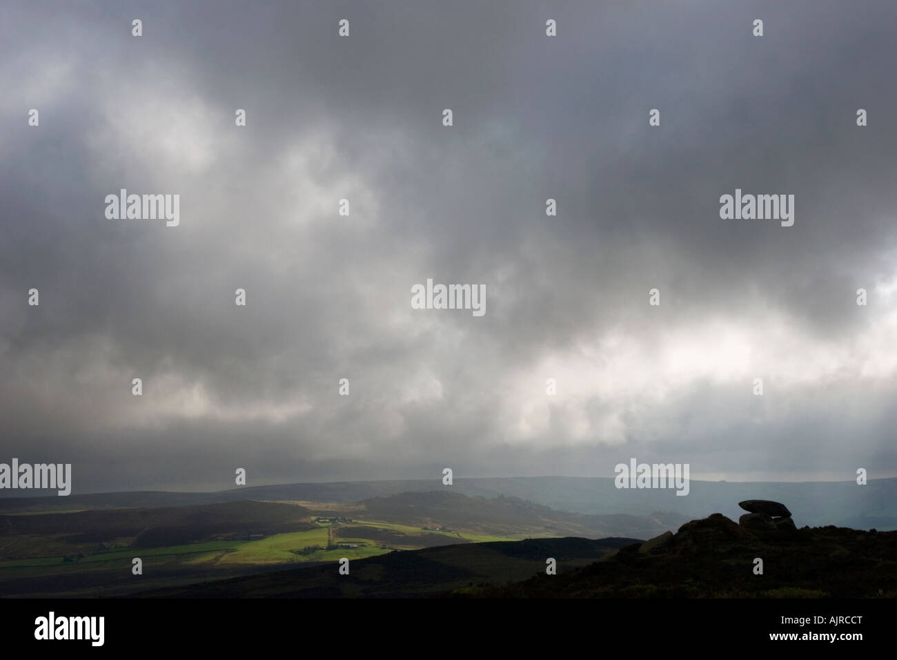 Dark clouds over the Roaches near Leek in the Stafordshire Moorlands - Stock Image