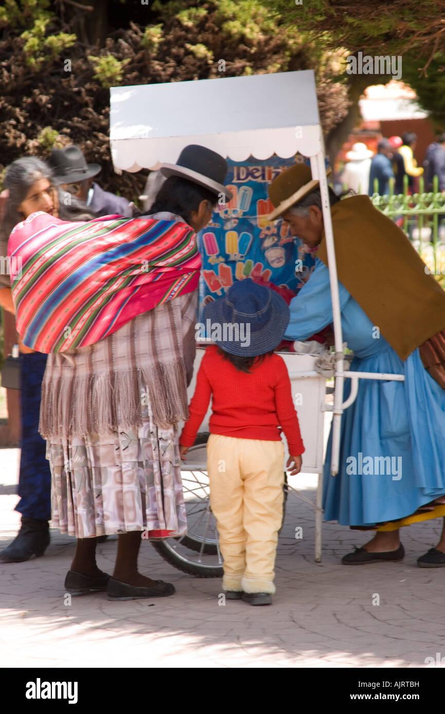 Aymara women in the Plaza 2 de Febrero in Copacabana a town on the shores of Lake Titicaca, Bolivia near the border Stock Photo