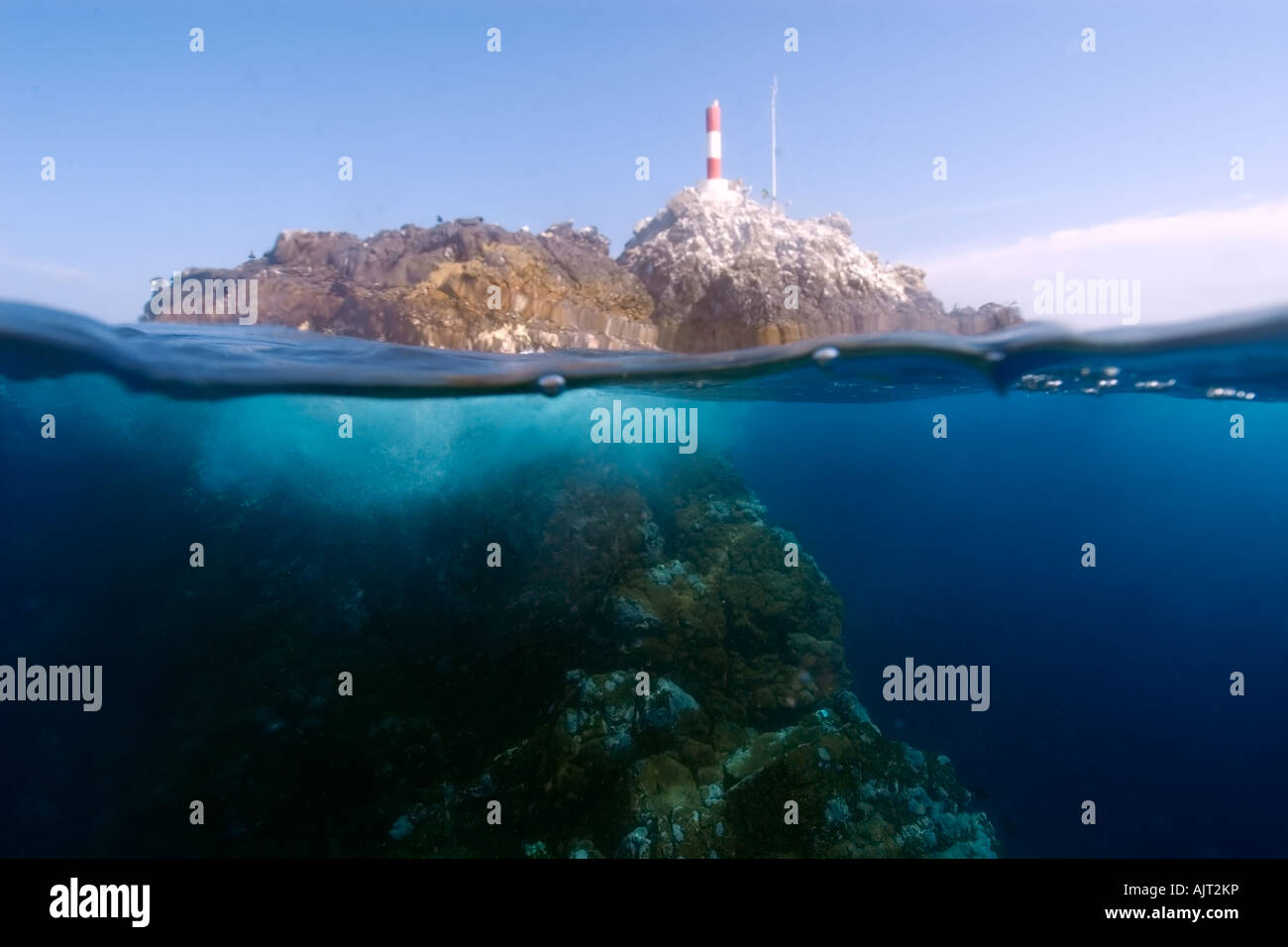 Split image of rocks lighthouse and underwater substrate St Peter and St Paul s rocks Brazil Atlantic Ocean - Stock Image