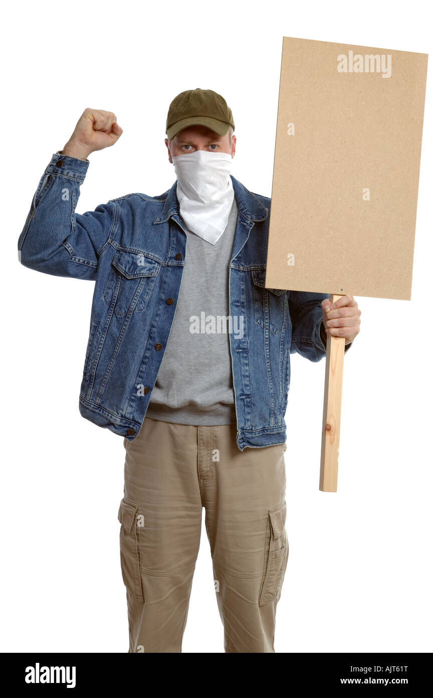 Masked protester with clenched fist holding a blank placard for you to add your own text - Stock Image