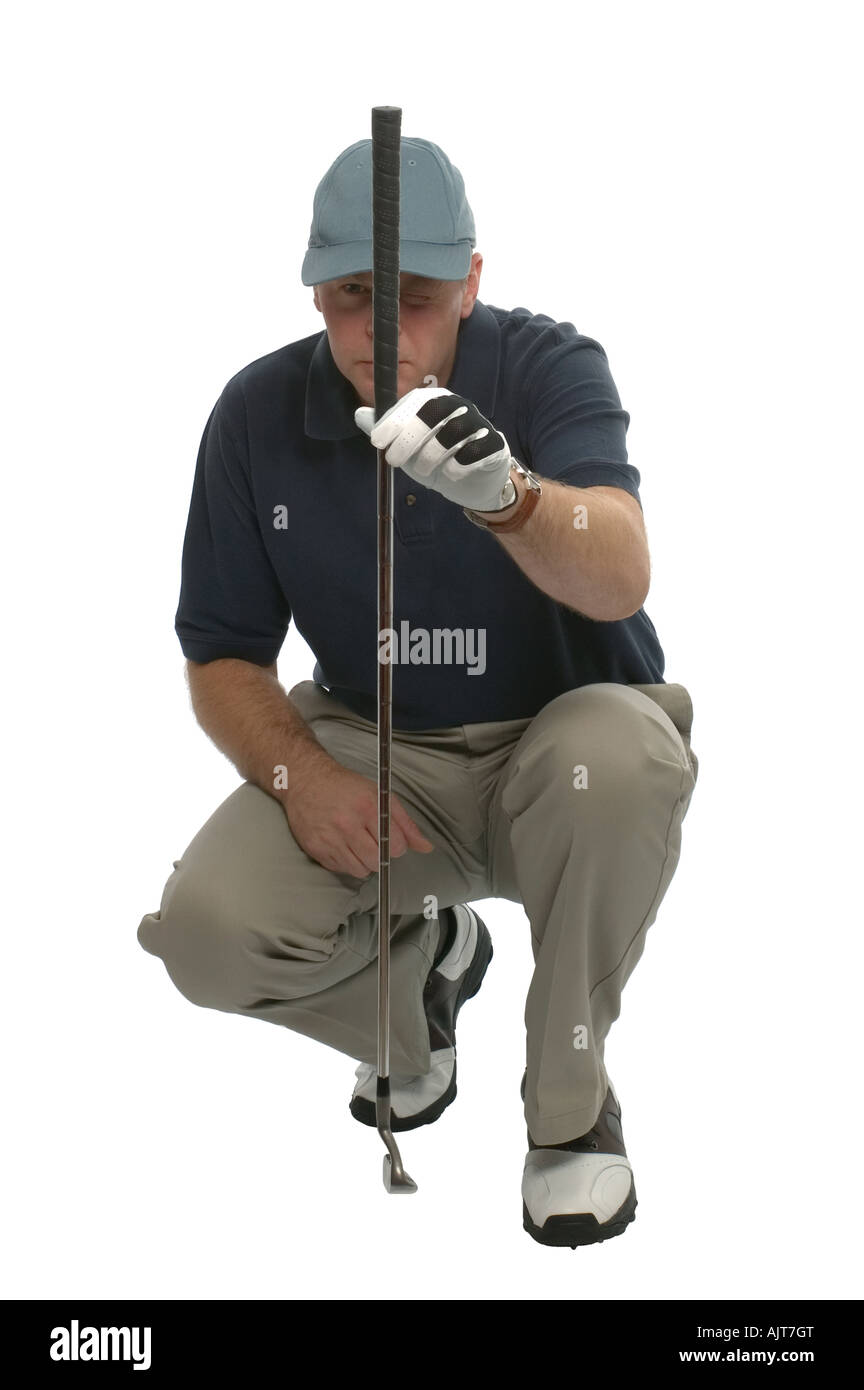 Golfer crouched down lining up a putt - Stock Image