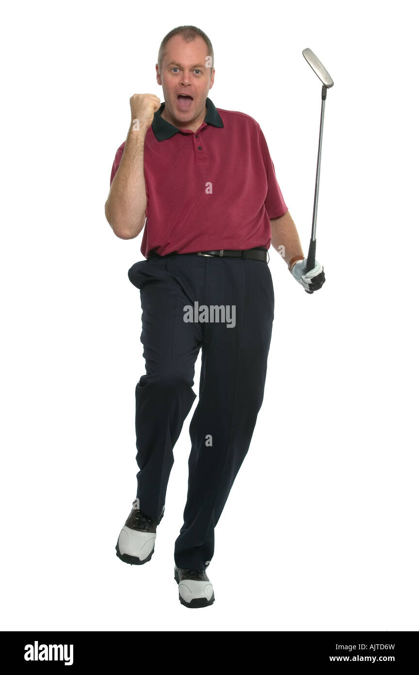 Golfer in a red shirt celebrating after sinking a great putt - Stock Image
