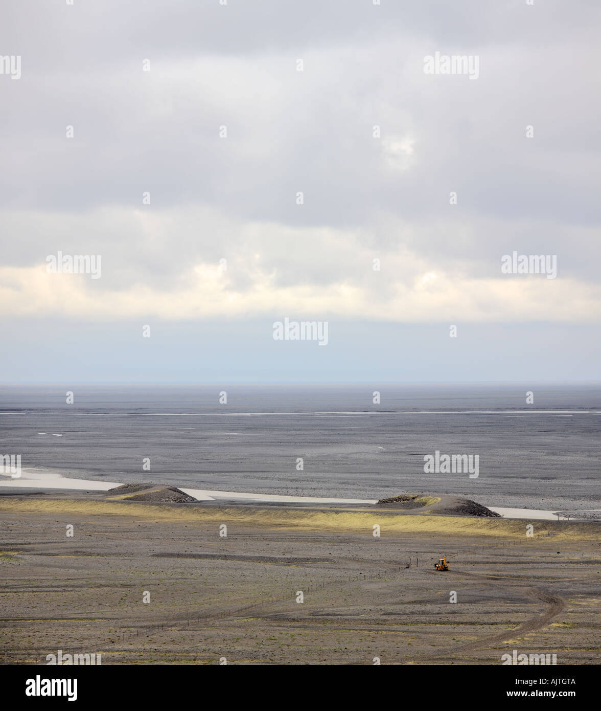 Flood plains and a yellow backhoe in Vatnajökull National Park, Iceland Stock Photo