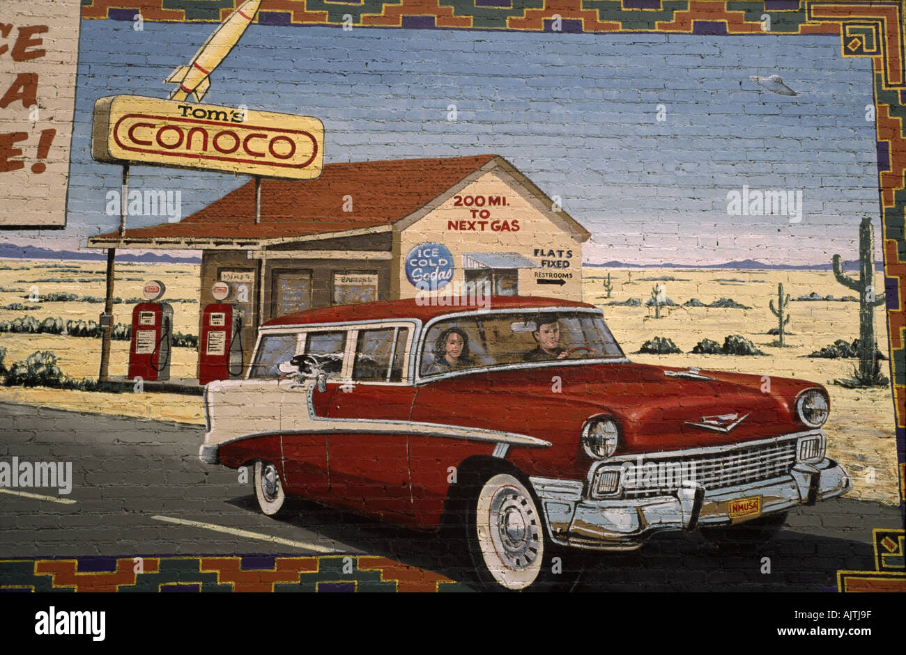 1956 Chevrolet Bel Air Station Wagon and historic gas station at ...