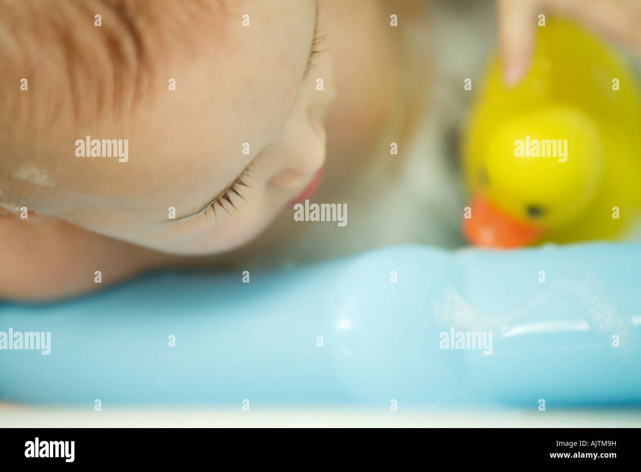 Baby taking bath, extreme close-up, cropped view - Stock Image
