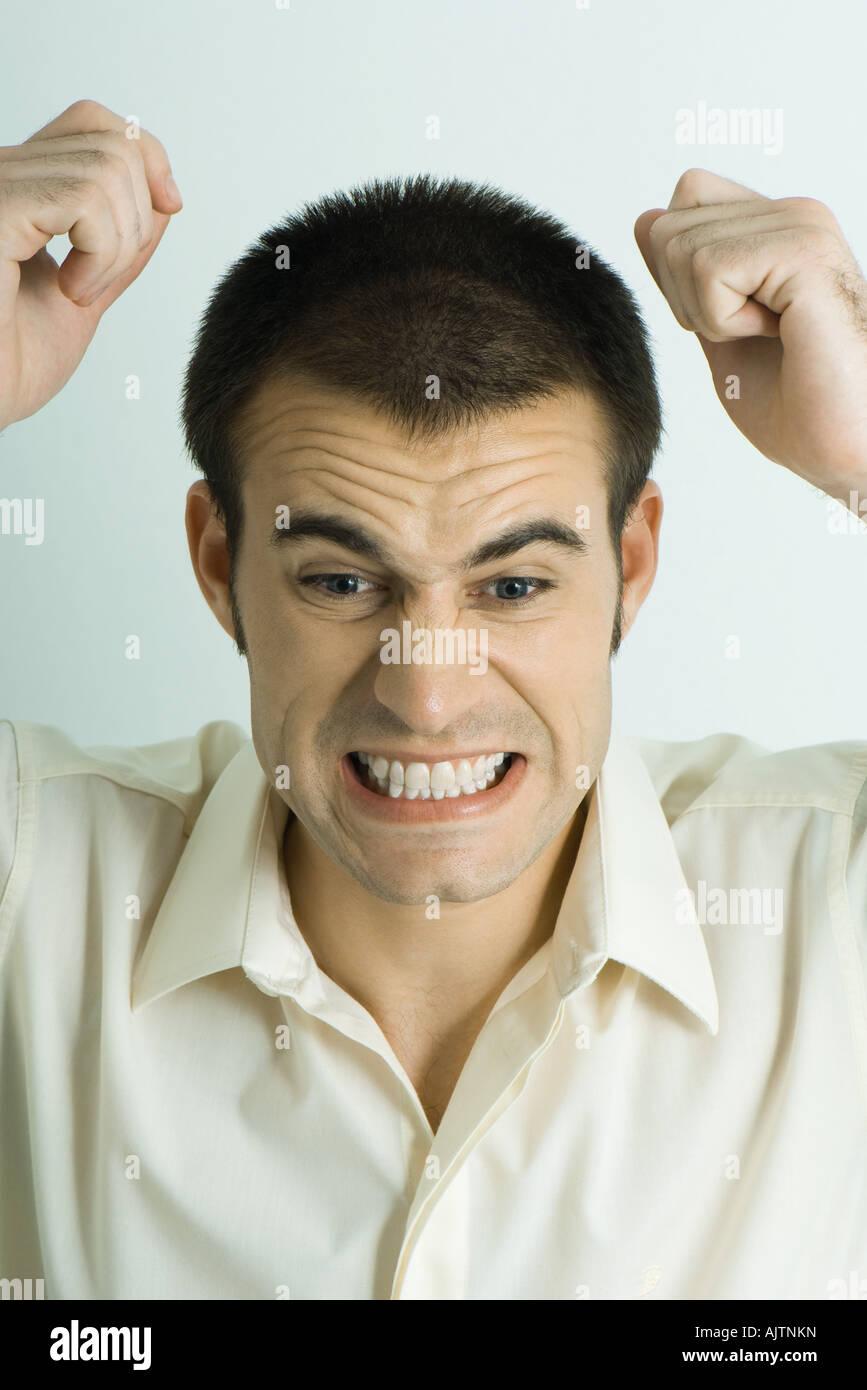 Man throwing tantrum, portrait - Stock Image