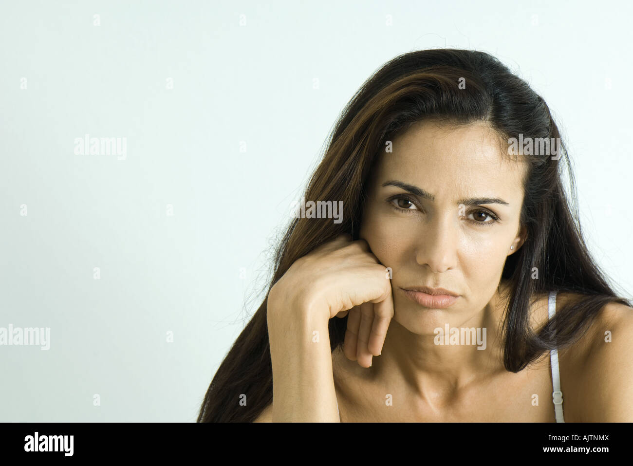 Woman pouting, looking at camera, portrait - Stock Image