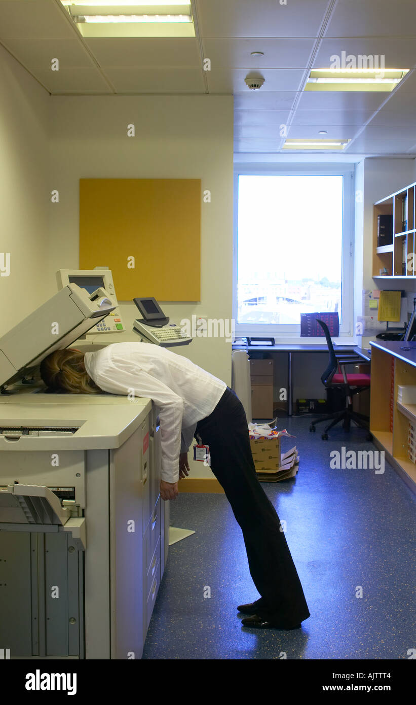 Office Life And Interiors Part Two Woman Asleep On A Photocopier
