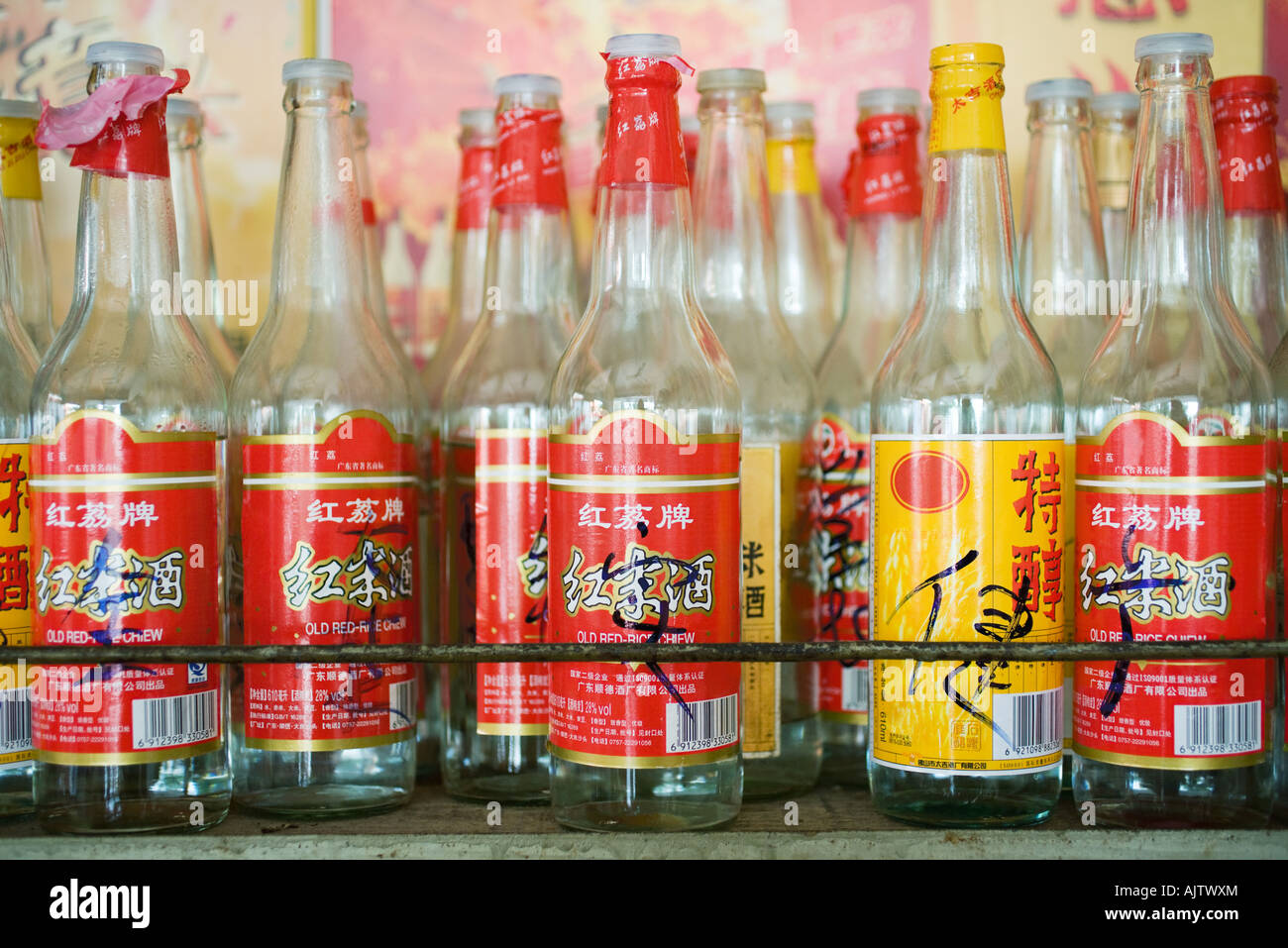 Empty bottles with Chinese script on labels - Stock Image