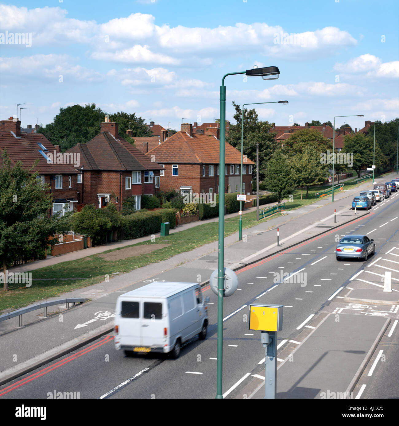 dual carriageway with traffic speed camera houses red route in stock