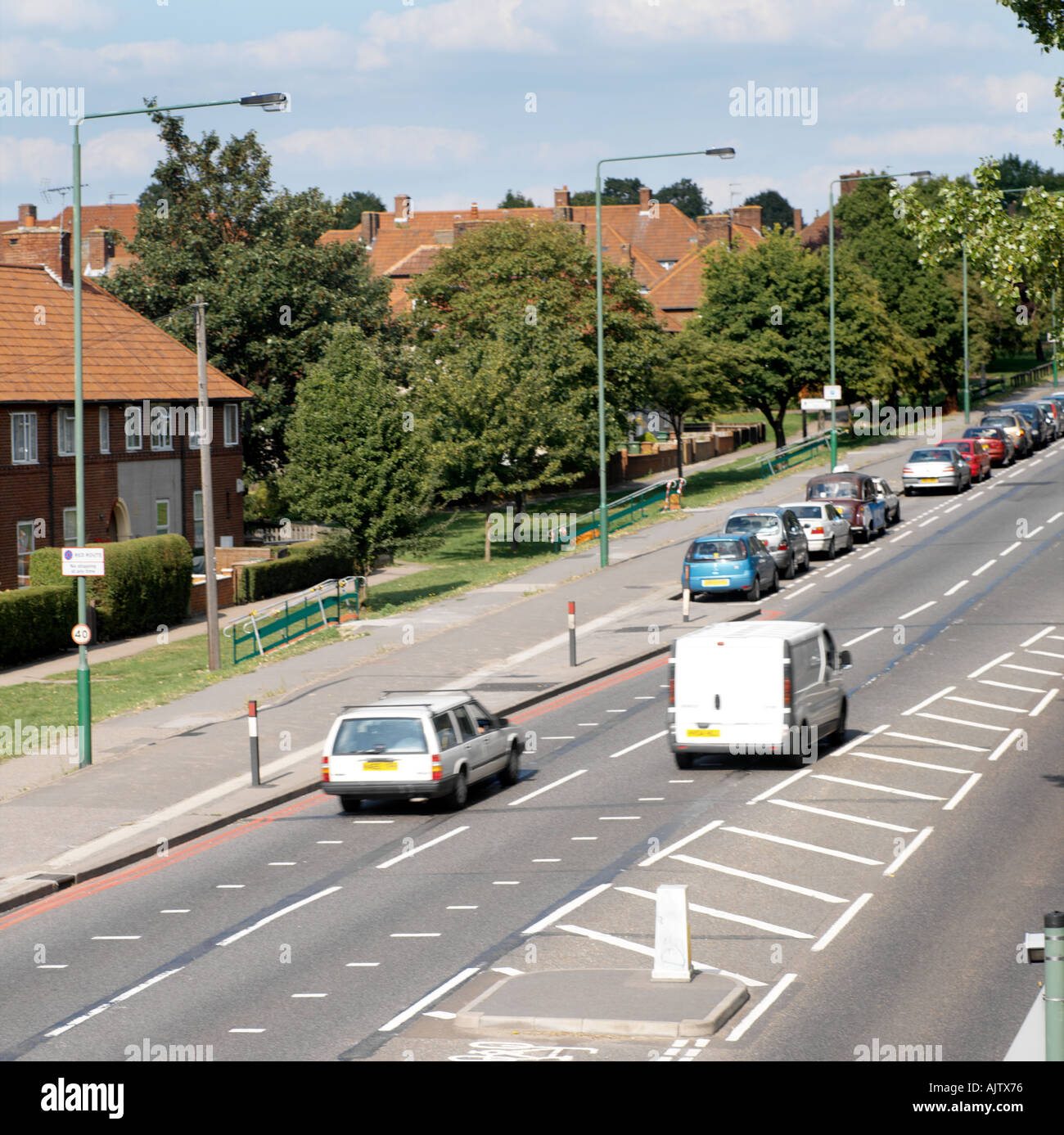 Dual Carriageway with Traffic Houses Red Route in Rosehill Surrey England - Stock Image