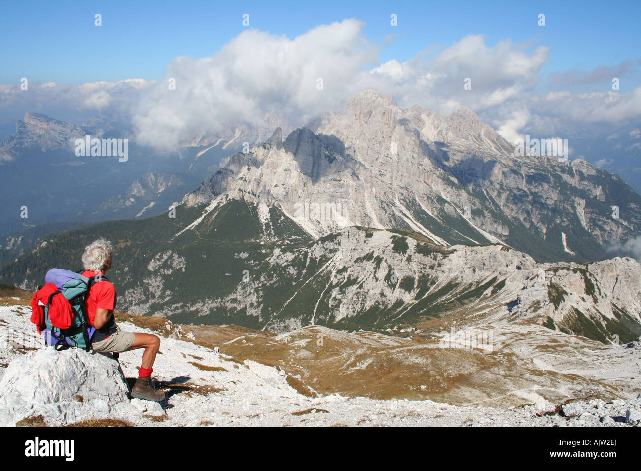 Walker on the Alta Via 1 enjoying the stunning views in the Dolomiti Bellunies, Veneto, Italy - Stock Image