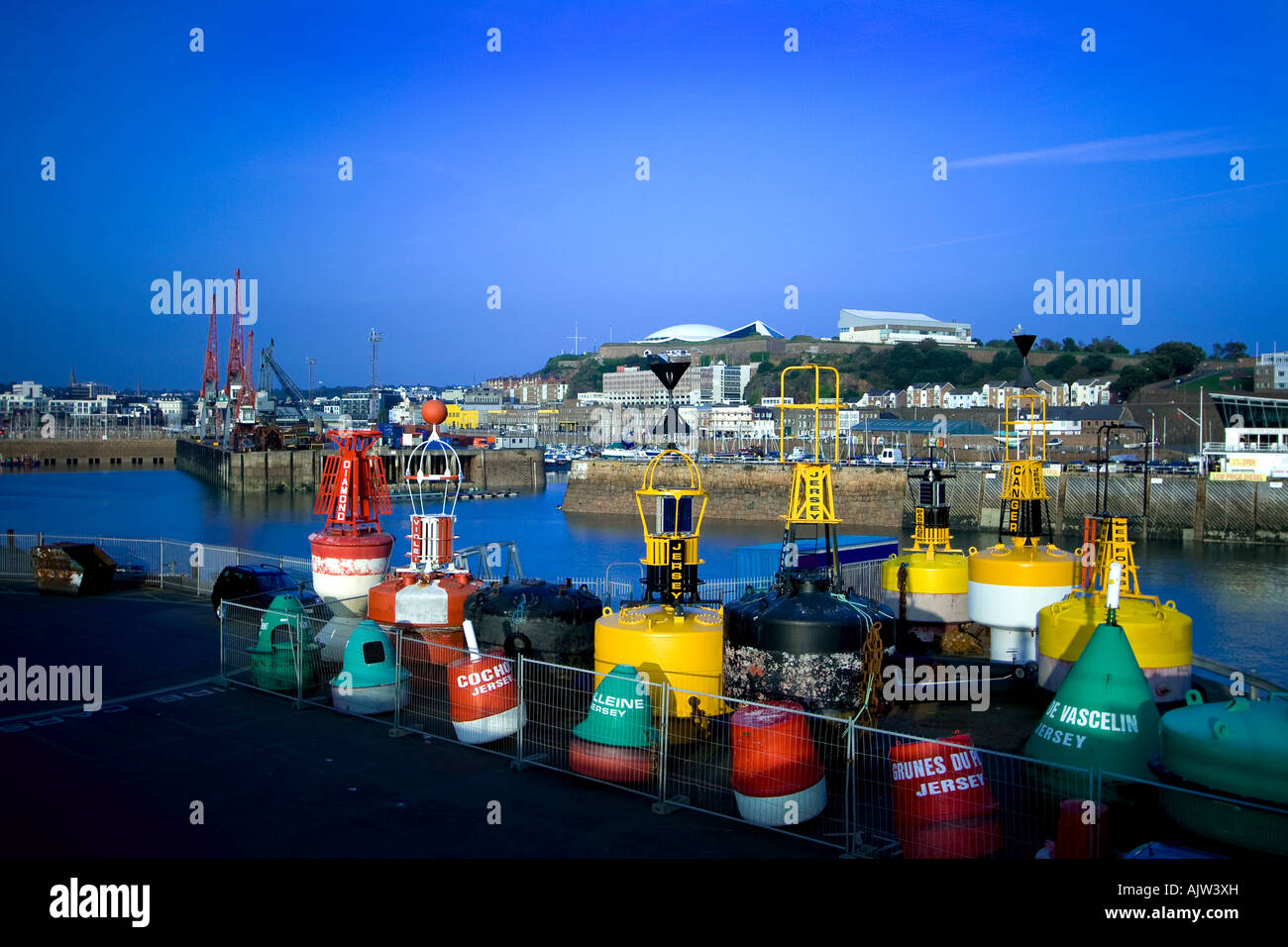 98af472a782b View of Navigation Buoys in foreground, and St. Helier Harbour Port in  background with Fort Regent above.