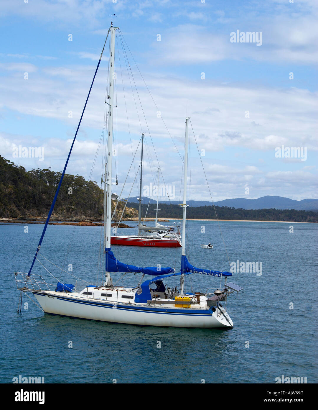 Yachts anchored in the safety of  the bay. Stock Photo