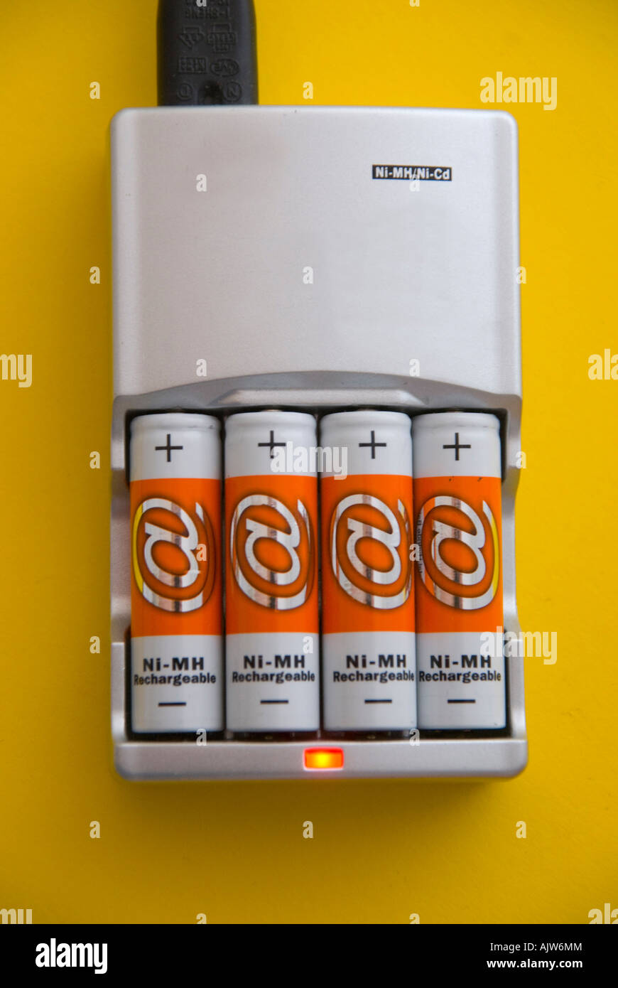 NiMH batteries and charger Stock Photo