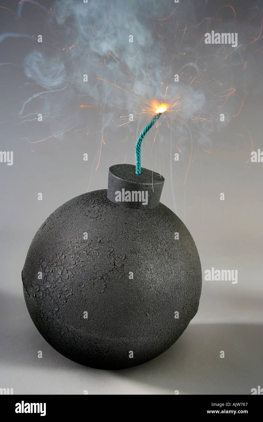 An old fasdhioned style round bomb with a lit fuse about to explode - Stock Image
