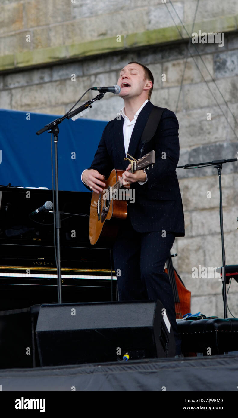 David Gray singing performing on stage at Newport Folk Festival. - Stock Image