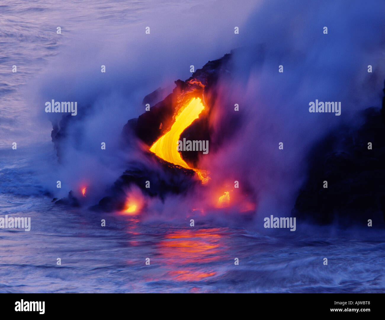 Lava flowing into the ocean and cooling, Kilauea Volcano, Hawaii - Stock Image