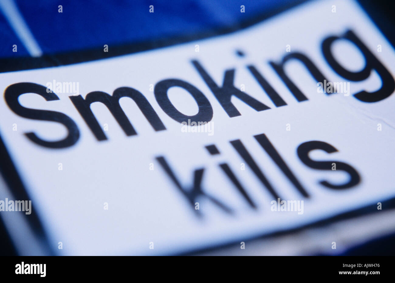 Close up of a notice on a crumpled cigarette packet stating Smoking kills - Stock Image