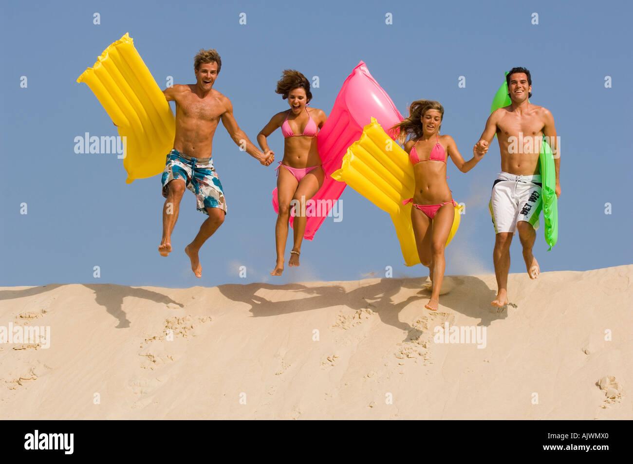 people having fun at the beach - Stock Image