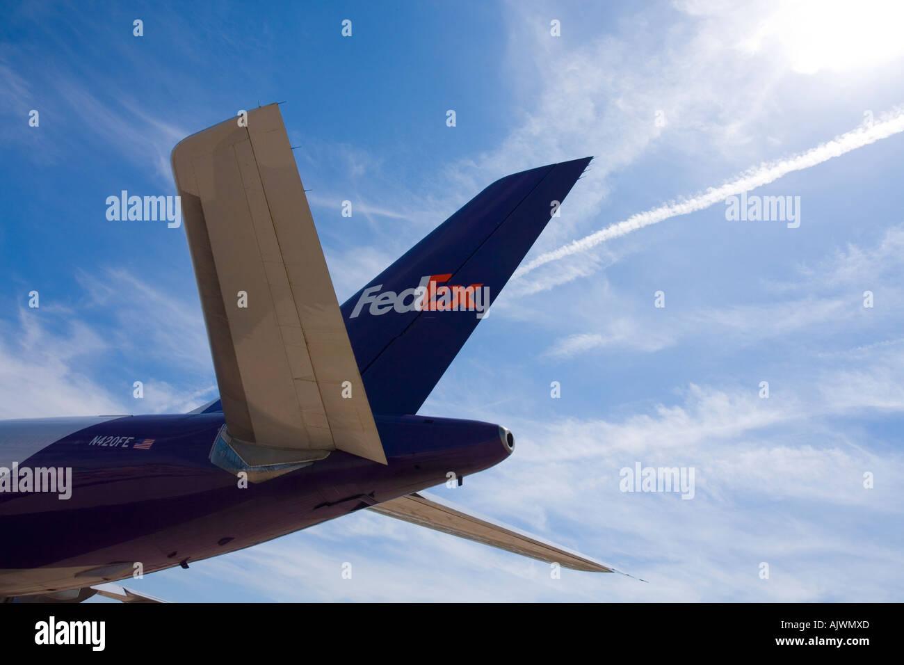 Fedex Aircraft tailplane tail plane airplane aeroplane against blue sky - Stock Image