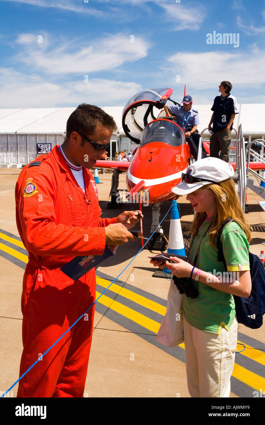 Red Arrows RAF aerobatic display team pilot signs autograph at Fairford International Air Show 2006 Gloucestershire England - Stock Image
