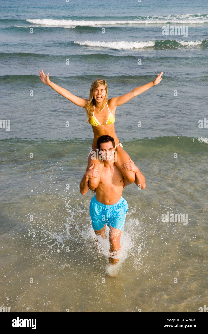 couple having fun on the beach - Stock Image