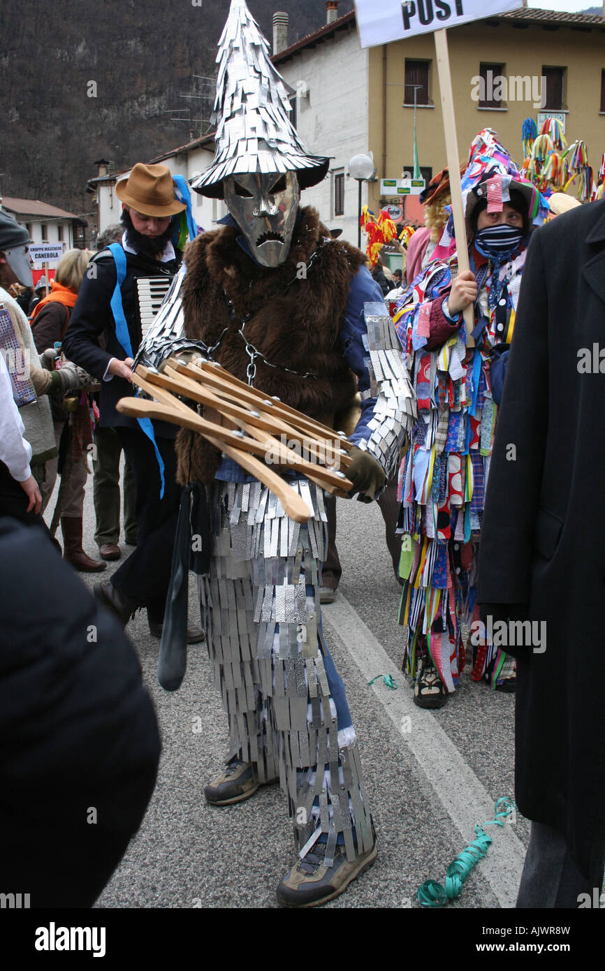 Costumed participant at Carnival in Pulfero, Friuli, Italy - Stock Image