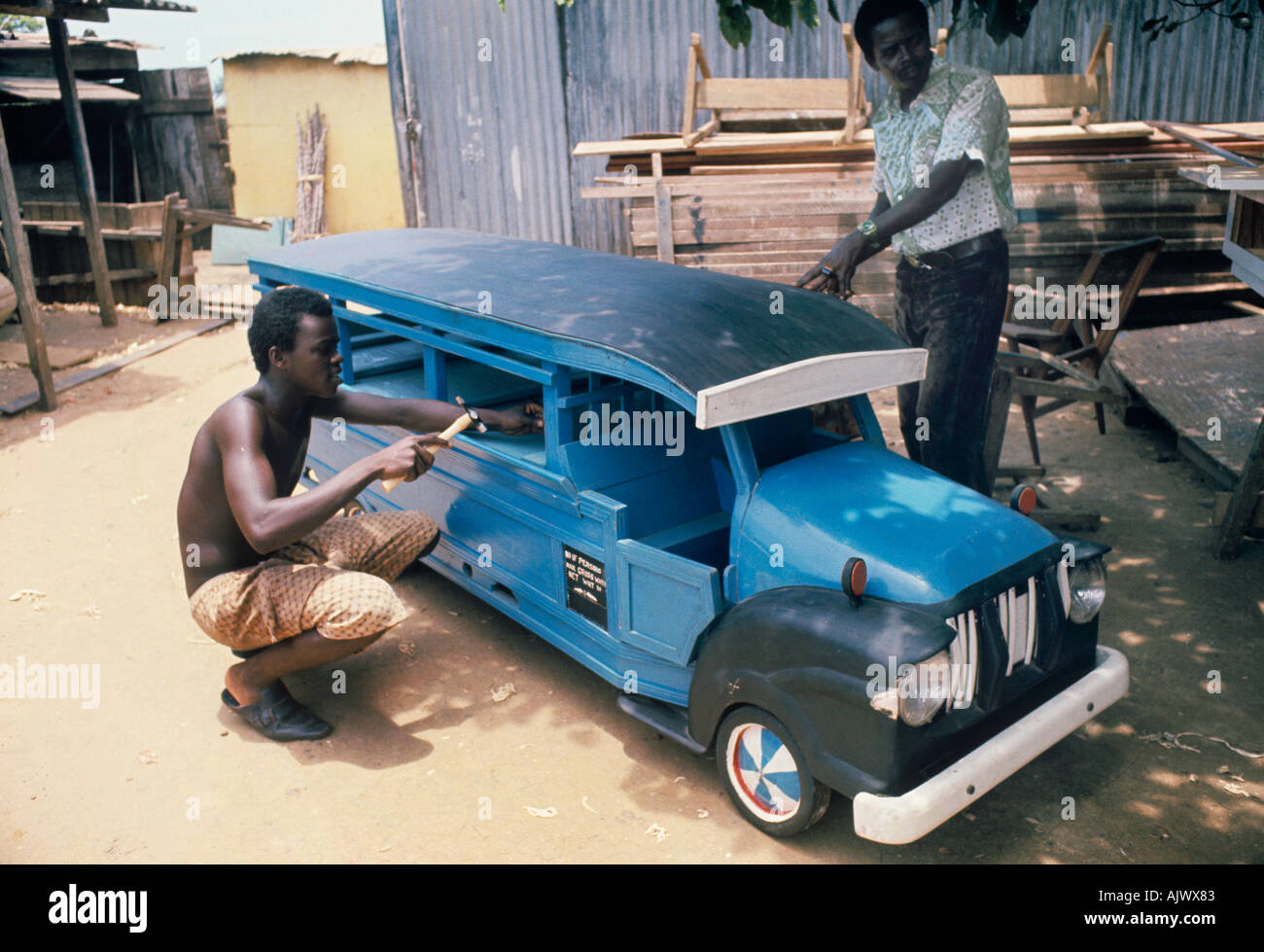 Ghanaians seeking a grand funeral can order a splendid custom coffin shaped like a bus, a bird, a boat, or any dying wish - Stock Image