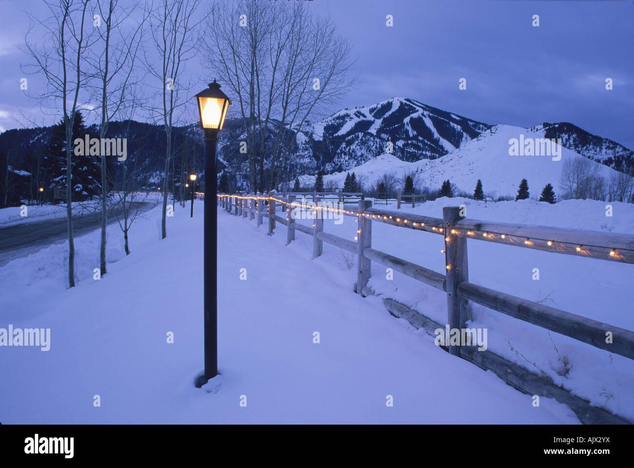 Dawn lighting fence winter Sun Valley, Idaho. - Stock Image