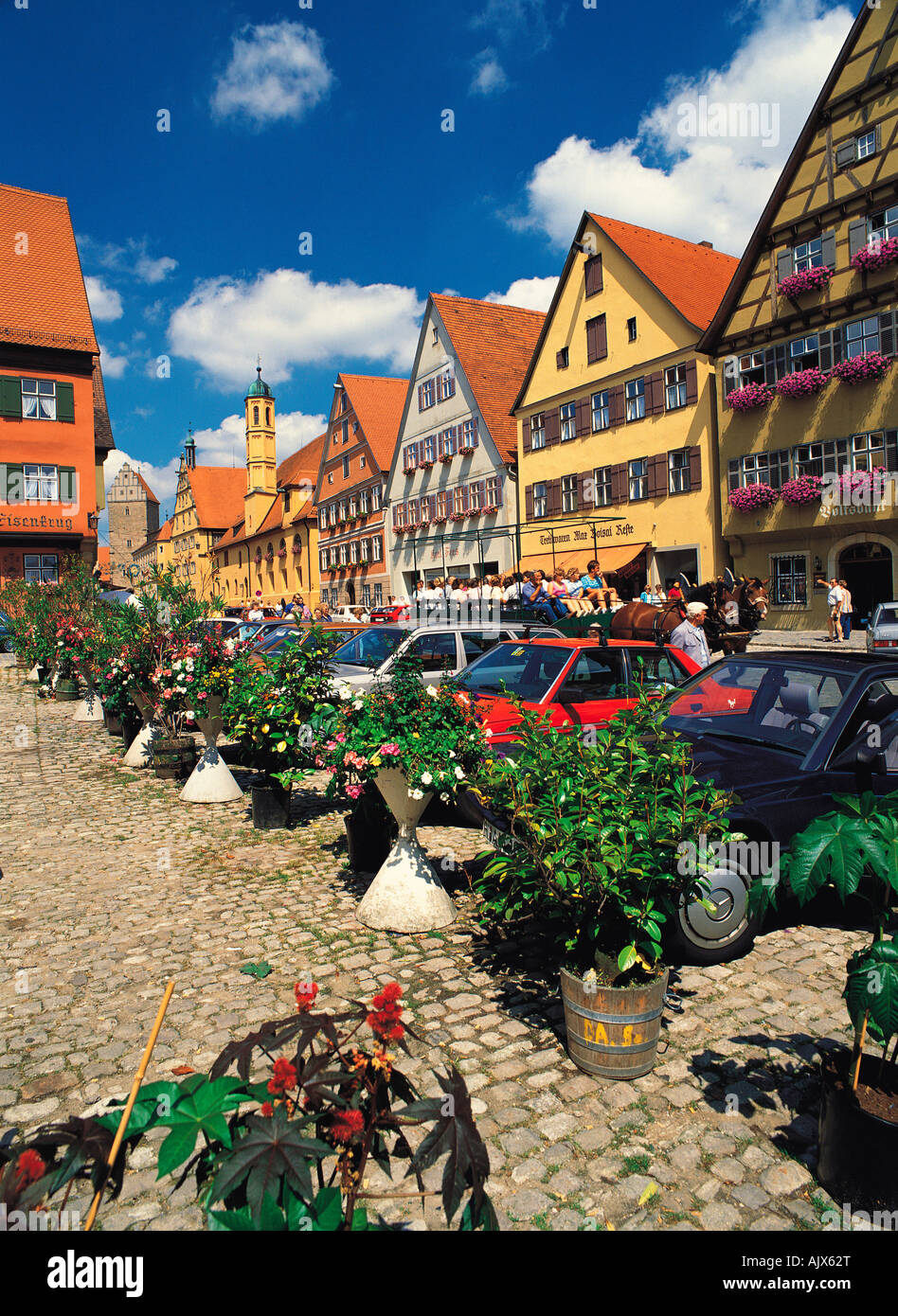 Germany. Dinkelsbuhl. Street scene with parked cars and old buildings. - Stock Image
