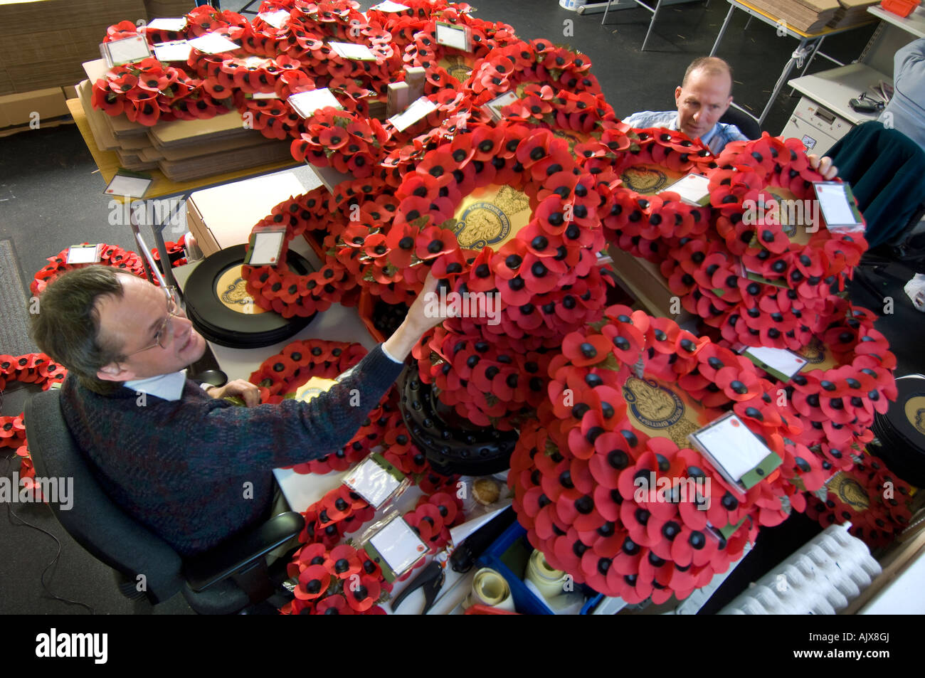 Workers at the Royal British Legion Poppy Factory in Richmond Surrey - Stock Image