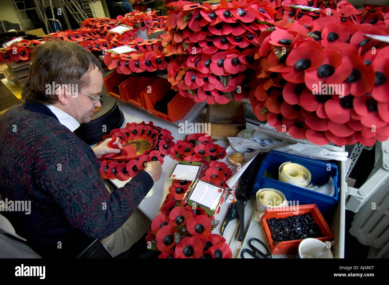 Worker at the Royal British Legion Poppy Factory in Richmond Surrey - Stock Image