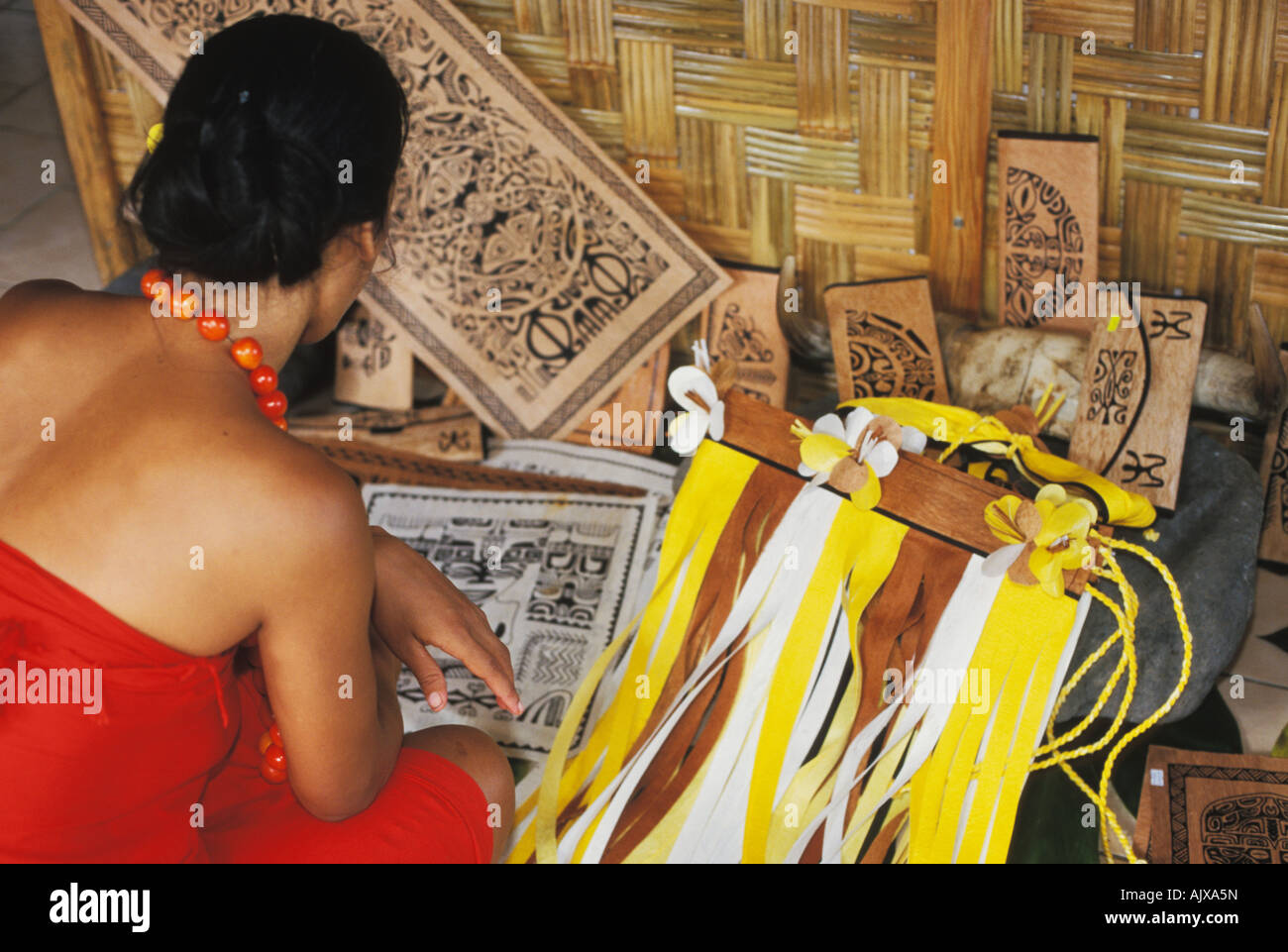 Woman artist and tapa painting in Omoa on Fatu Hiva in the Marquesas, French Polynesia - Stock Image