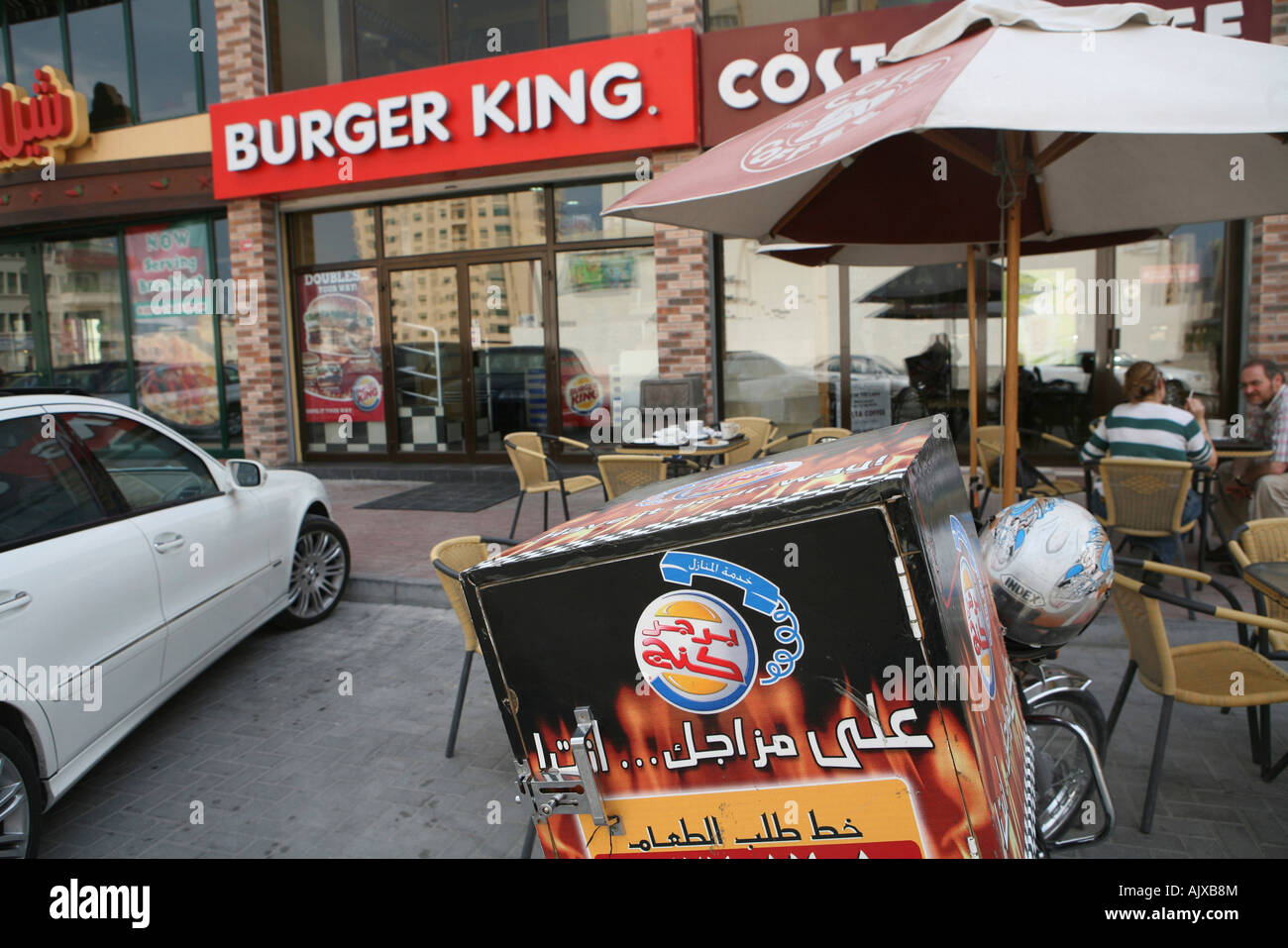 The home delivery motorbike sits in front of a Burger King