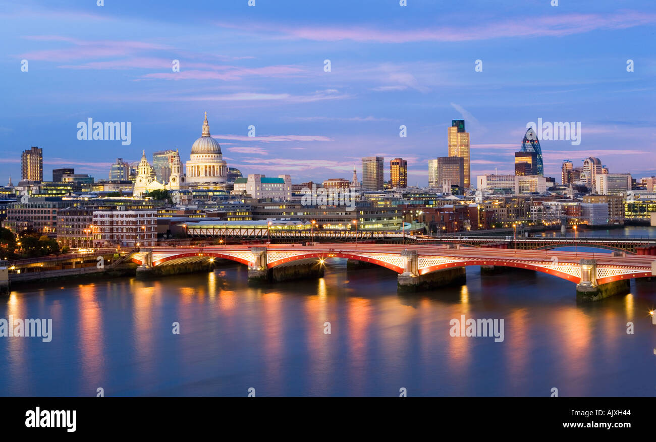 UK London View over river Thames to St pauls cathedral and city skyline - Stock Image